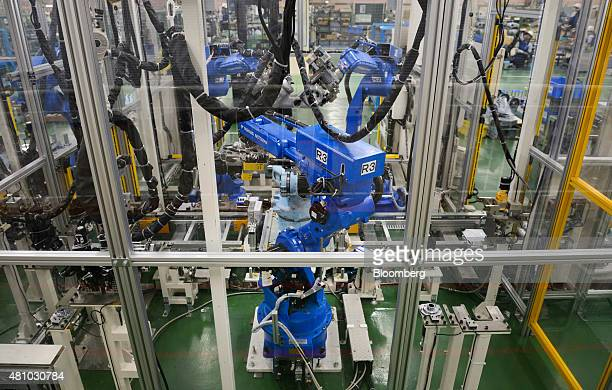 Yaskawa Electric Corp Motoman robots manufacture a Motoman robot at the company's factory in Kitakyushu Japan on Thursday July 16 2015 In factory...