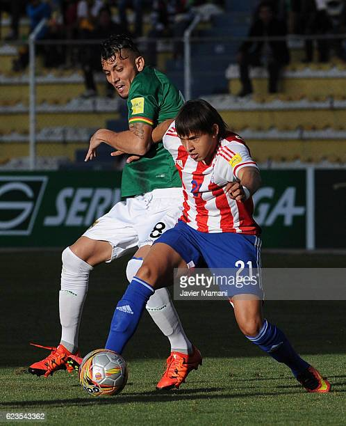 Yasmani Duck of Bolivia fights for the ball with Oscar Romero of Paraguay during a match between Bolivia and Paraguay as part of FIFA 2018 World Cup...