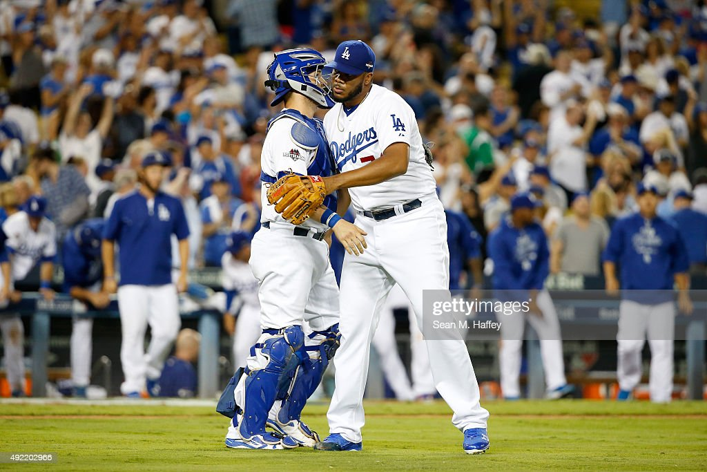 Yasmani Grandal #9 and Kenley Jansen #74 of the Los Angeles Dodgers celebrate after the Dodgers 5-2 victory against the New York Mets in game two of the National League Division Series at Dodger Stadium on October 10, 2015 in Los Angeles, California.