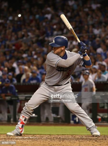 Yasmani Grandal of the Los Angeles Dodgers bats against the Arizona Diamondbacks during the MLB game at Chase Field on August 9 2017 in Phoenix...