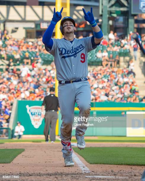 Yasmani Grandal of the Los Angeles Dodgers hits a solo home run in the ninth inning against the Detroit Tigers during a MLB game at Comerica Park on...
