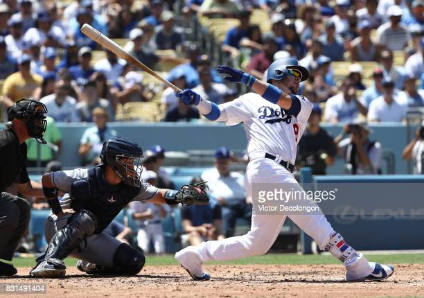 Yasmani Grandal of the Los Angeles Dodgers hits a tworun homerun during the fourth inning of the MLB game against the San Diego Padres at Dodger...