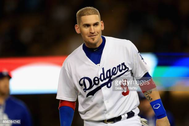 Yasmani Grandal of the Los Angeles Dodgers looks on during a game against the San Diego Padres at Dodger Stadium on September 26 2017 in Los Angeles...