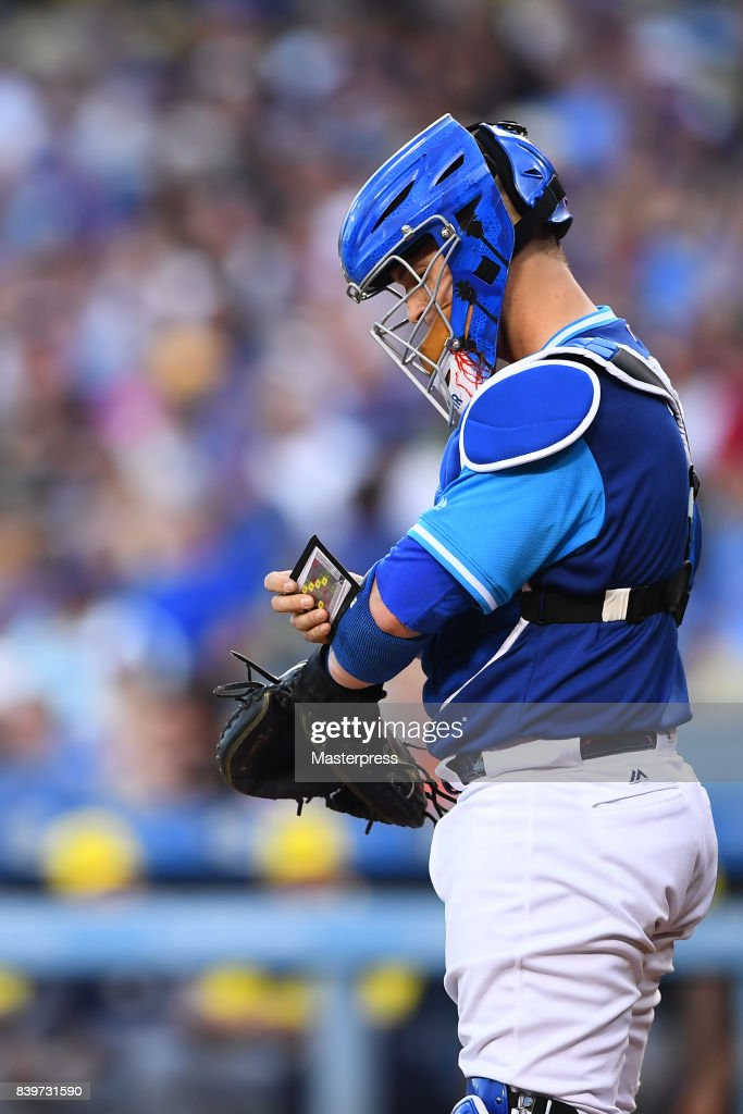 Yasmani Grandal #9 of the Los Angeles Dodgers looks on during the game against the Milwaukee Brewers at Dodger Stadium on August 26, 2017 in Los Angeles, California.