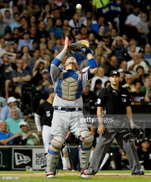 Yasmani Grandal of the Los Angeles Dodgers makes a catch for an out on a bunt by Tyler Saladino of the Chicago White Sox during the sixth inning at...