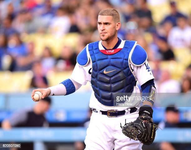 Yasmani Grandal of the Los Angeles Dodgers reacts after his dropped ball while tagging Ender Inciarte of the Atlanta Braves resulting in a 10 Braves...