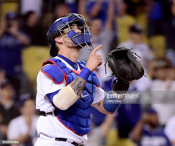 Yasmani Grandal of the Los Angeles Dodgers reacts after the final Colorado Rockies out and his two homeruns in the game for a 74 win at Dodger...