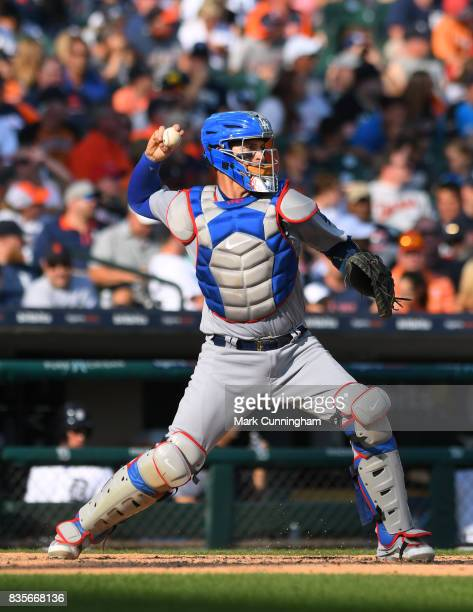 Yasmani Grandal of the Los Angeles Dodgers throws a baseball during the game against the Detroit Tigers at Comerica Park on August 19 2017 in Detroit...
