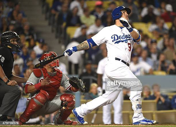 Yasmani Grandal of the Los Angeles Dodgers watches his three run homerun with Carlos Ruiz of the Philadelphia Phillies and umpire Jim Reynolds to te...