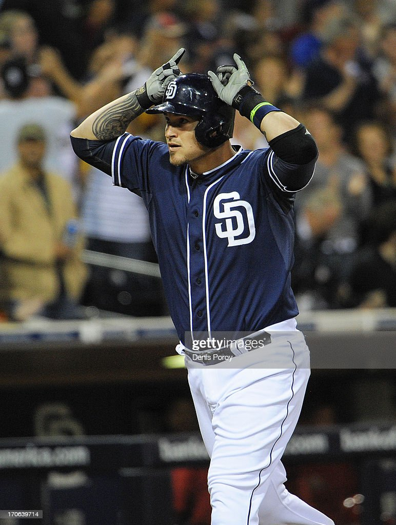 Yasmani Grandal #12 of the San Diego Padres celebrates after hitting a three-run homer in the fourth inning of a baseball game against the Arizona Diamondbacks at Petco Park on June 15, 2013 in San Diego, California.