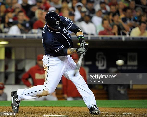 Yasmani Grandal of the San Diego Padres hits a threerun homer in the fourth inning of a baseball game against the Arizona Diamondbacks at Petco Park...