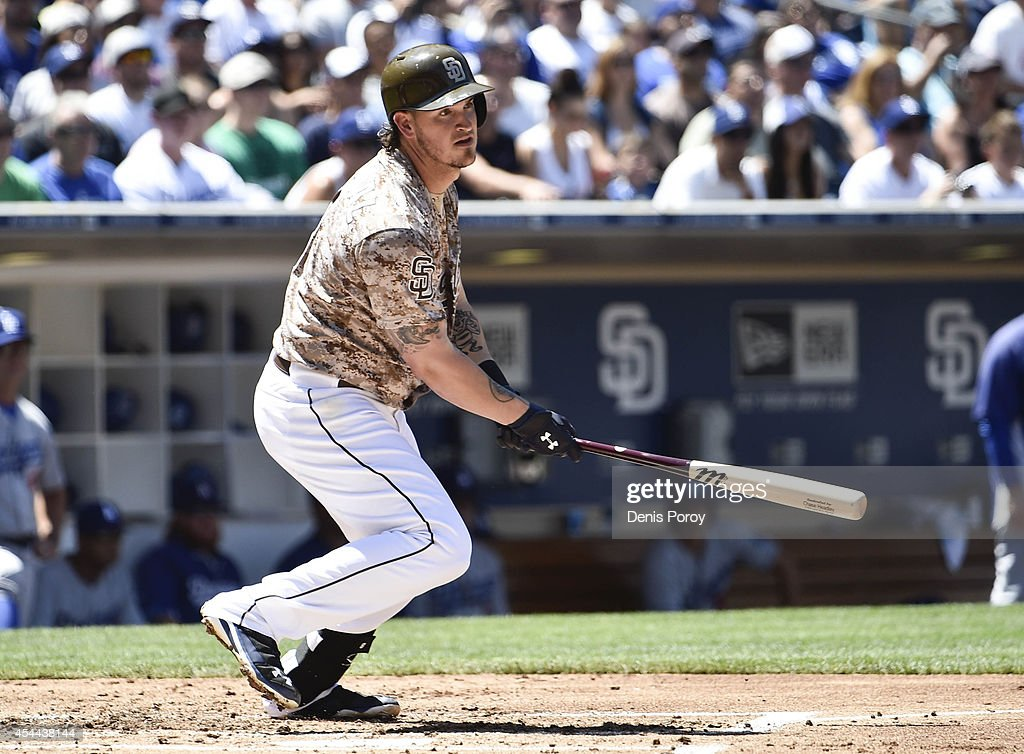 <a gi-track='captionPersonalityLinkClicked' href=/galleries/search?phrase=Yasmani+Grandal&family=editorial&specificpeople=7510522 ng-click='$event.stopPropagation()'>Yasmani Grandal</a> #8 of the San Diego Padres hits an RBI double during the first inning of a baseball game against the Los Angeles Dodgers at Petco Park August, 31, 2014 in San Diego, California.