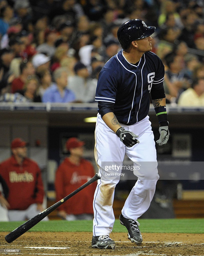 Yasmani Grandal #12 of the San Diego Padres watches the flight of his three-run homer in the fourth inning of a baseball game against the Arizona Diamondbacks at Petco Park on June 15, 2013 in San Diego, California.
