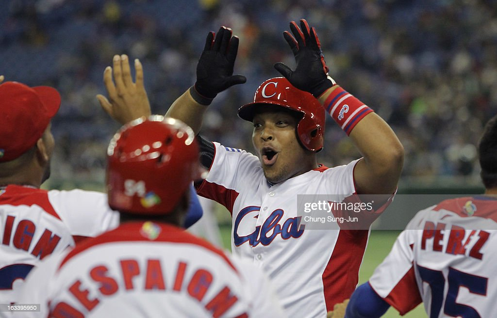 Yasmany Tomas # 27 of Cuba celebrates with team mates after three run home run bottom of the fourth inning during the World Baseball Classic Second Round Pool 1 game between Chinese Taipei and Cuba at Tokyo Dome on March 9, 2013 in Tokyo, Japan.