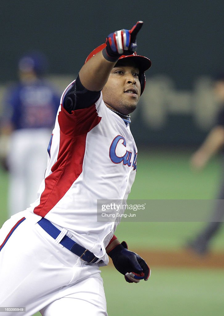 Yasmany Tomas # 27 of Cuba reacts after three run home run bottom of the fourth inning during the World Baseball Classic Second Round Pool 1 game between Chinese Taipei and Cuba at Tokyo Dome on March 9, 2013 in Tokyo, Japan.