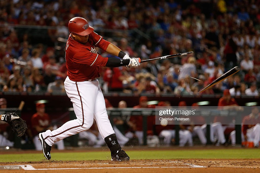 Yasmany Tomas #24 of the Arizona Diamondbacks breaks his bat as he hits a ground ball out during the first inning of the MLB game against the Los Angeles Dodgers at Chase Field on July 1, 2015 in Phoenix, Arizona.