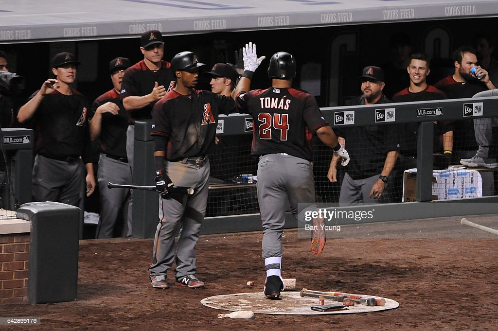 Yasmany Tomas #24 of the Arizona Diamondbacks celebrate a run in the ninth inning against the Colorado Rockies at Coors Field on June 24, 2016 in Denver, Colorado. The Diamondbacks defeat the Rockies 10-9.