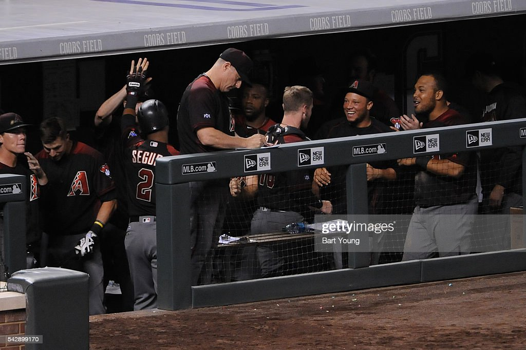 Yasmany Tomas #24 of the Arizona Diamondbacks celebrate with his team mates in the ninth inning against the Colorado Rockies at Coors Field on June 24, 2016 in Denver, Colorado. The Diamondbacks defeat the Rockies 10-9.