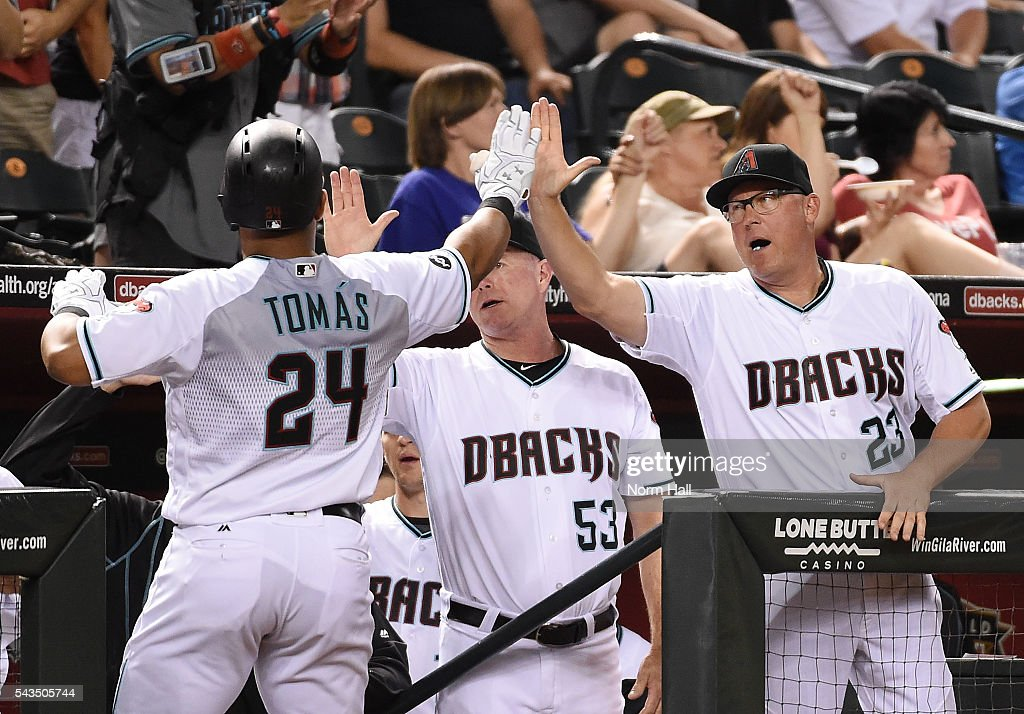 Yasmany Tomas #24 of the Arizona Diamondbacks celebrates with pitching coach Mike Butcher #23 after hitting a solo home run during the sixth inning off of Jerad Eickhoff #48 of the Philadelphia Phillies at Chase Field on June 28, 2016 in Phoenix, Arizona.