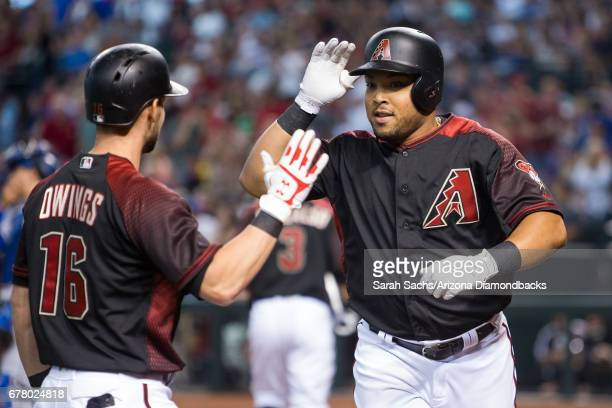 Yasmany Tomas of the Arizona Diamondbacks highfives Chris Owings after hitting a home run during a game against the Los Angeles Dodgers at Chase...