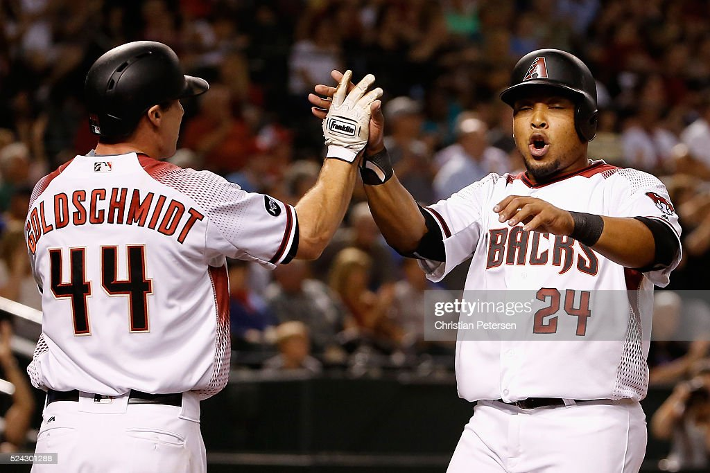 Yasmany Tomas #24 of the Arizona Diamondbacks high-fives <a gi-track='captionPersonalityLinkClicked' href=/galleries/search?phrase=Paul+Goldschmidt&family=editorial&specificpeople=7511120 ng-click='$event.stopPropagation()'>Paul Goldschmidt</a> #44 afte scoring against the St. Louis Cardinals during the sixth inning of the MLB game at Chase Field on April 25, 2016 in Phoenix, Arizona.