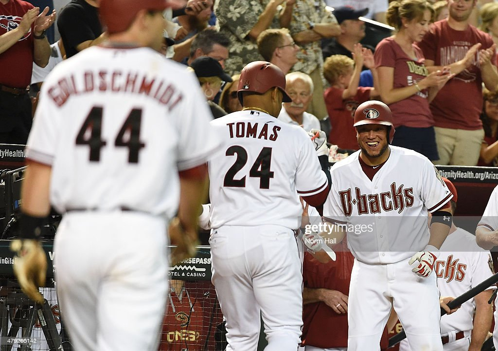 Yasmany Tomas #24 of the Arizona Diamondbacks is greeted by teammate <a gi-track='captionPersonalityLinkClicked' href=/galleries/search?phrase=Welington+Castillo&family=editorial&specificpeople=4959193 ng-click='$event.stopPropagation()'>Welington Castillo</a> #7 after hitting a two run home run during the sixth inning against the Los Angeles Dodgers at Chase Field on June 29, 2015 in Phoenix, Arizona.