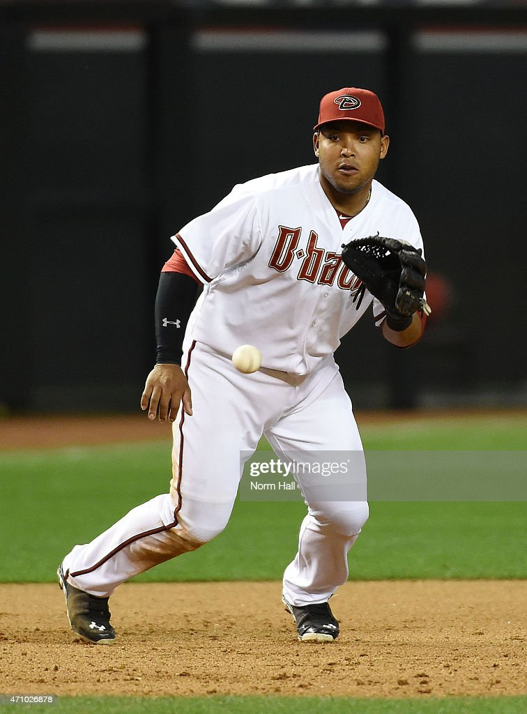 Yasmany Tomas #24 of the Arizona Diamondbacks makes a play on a bouncing ball to get an out during the eighth inning against the Pittsburgh Pirates at Chase Field on April 24, 2015 in Phoenix, Arizona. Pittsburgh won 4-1.