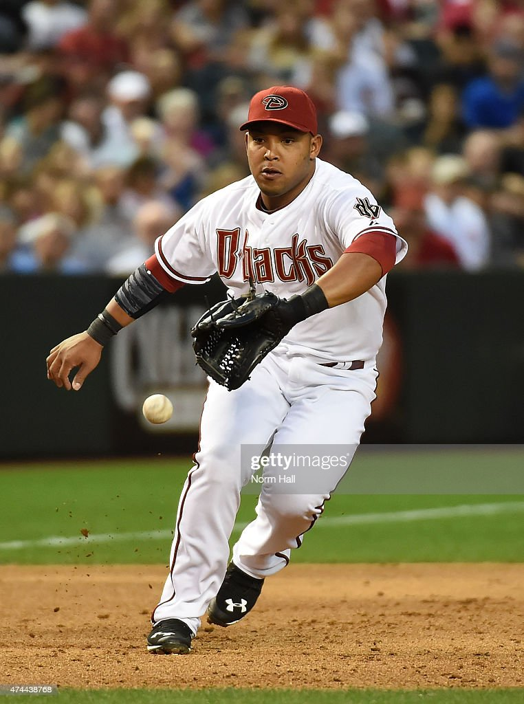 Yasmany Tomas #24 of the Arizona Diamondbacks makes a play on a ground ball during the third inning against the Chicago Cubs at Chase Field on May 22, 2015 in Phoenix, Arizona.