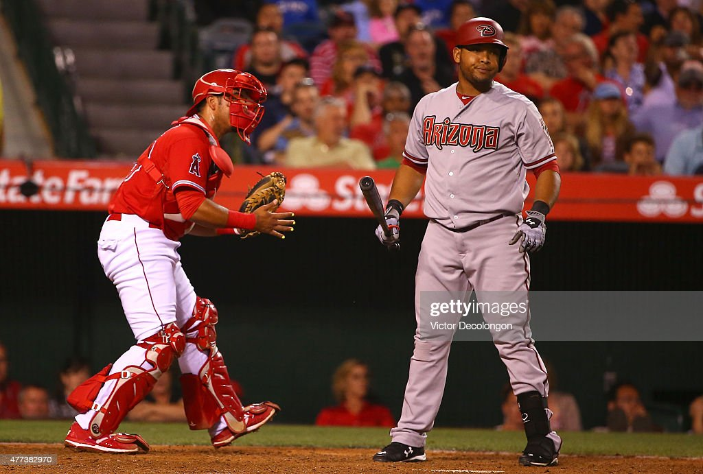Yasmany Tomas #24 of the Arizona Diamondbacks reacts after striking out in the eighth inning as catcher Carlos Perez #58 of the Los Angeles Angels of Anaheim looks on during the MLB game at Angel Stadium of Anaheim on June 16, 2015 in Anaheim, California. The Angels defeated the Diamondbacks 4-1.