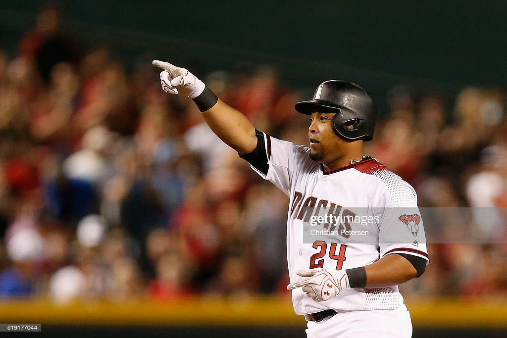 Yasmany Tomas #24 of the Arizona Diamondbacks reacts to a double hit against the Colorado Rockies during the second inning of the MLB opening day game at Chase Field on April 4, 2016 in Phoenix, Arizona.