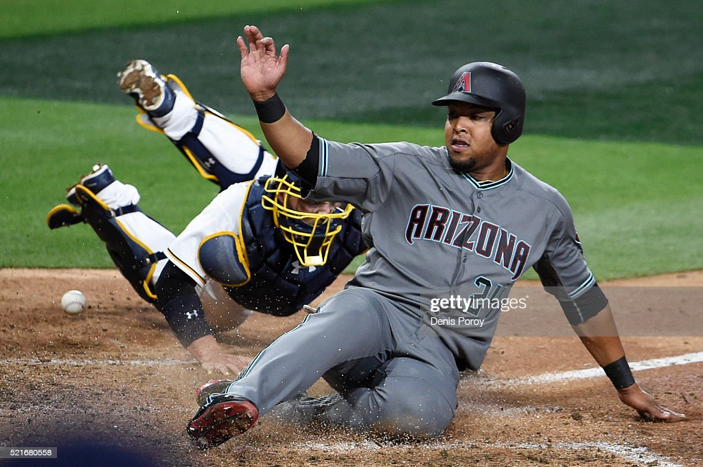 Yasmany Tomas #24 of the Arizona Diamondbacks scores ahead of the tag of <a gi-track='captionPersonalityLinkClicked' href=/galleries/search?phrase=Derek+Norris&family=editorial&specificpeople=6795804 ng-click='$event.stopPropagation()'>Derek Norris</a> #3 of the San Diego Padres during the seventh inning of a baseball game at PETCO Park on April 16, 2016 in San Diego, California.