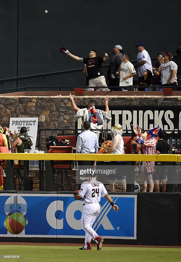 Yasmany Tomas of the Arizona Diamondbacks watches a home run ball off the bat of Corey Seager of the Los Angeles Dodgers fly over the pool in right...
