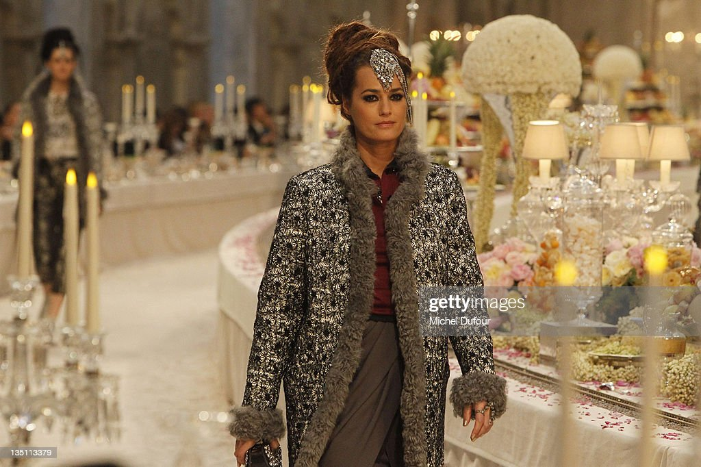 Yasmin Le Bon walks on the catwalk at the Chanel ParisBombay Show at Grand Palais on December 6 2011 in Paris France