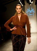 Yasmin Le Bon walks the catwalk at Issa London Fashion Week Autumn/Winter 2011 show at the BFC on February 19 2011 in London England