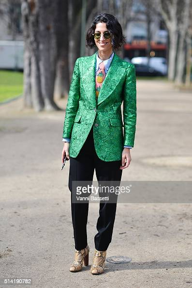 Yasmin Sewell poses wearing a Gucci jacket before the Giambattista Valli show at the Grand Palais during Paris Fashion Week FW 16/17 on March 7 2016...