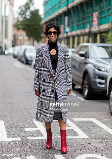 Yasmin Sewell wearing a grey plaid coat outside Mary Katrantzou during London Fashion Week Spring/Summer collections 2017 on September 18 2016 in...