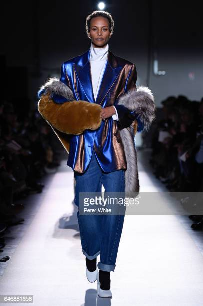 Yasmin Warsame walks the runway during the Dries Van Noten show as part of the Paris Fashion Week Womenswear Fall/Winter 2017/2018 on March 1 2017 in...