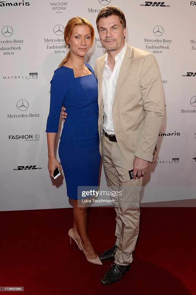 Yasmina Filali and Thomas Helmer attend the Laurel Show during the Mercedes-Benz Fashion Week Spring/Summer 2014 at Brandenburg Gate on July 4, 2013 in Berlin, Germany.