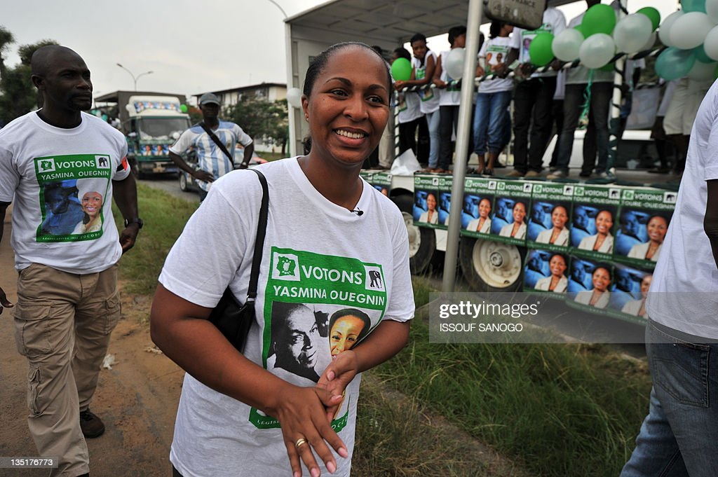 Yasmina Ouegnin, candidate of the Rally of Democratic Party of Ivory Coast (PDCI) for the upcoming legislative election, smiles as she arrives to attend a campaign rally in Cocody, a district of Abidjan, on December 7, 2011. The December 11 polls are being boycotted by Gbagbo's Ivorian Popular Front party and its allies in protest against his arrest and transfer to the International Criminal Court in The Hague. Nearly 1,000 candidates are in the fray for the 255 parliamentary seats.