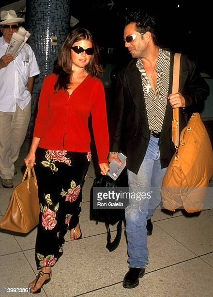 Yasmine Bleeth and Richard Grieco at the Yasmine Bleeth and Richard Grieco at Los Angeles International Airport Los Angeles International Airport Los...