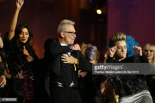 Yasmine Petty and Jean Paul Gaultier on stage the Life Ball 2015 show at City Hall on May 16 2015 in Vienna Austria