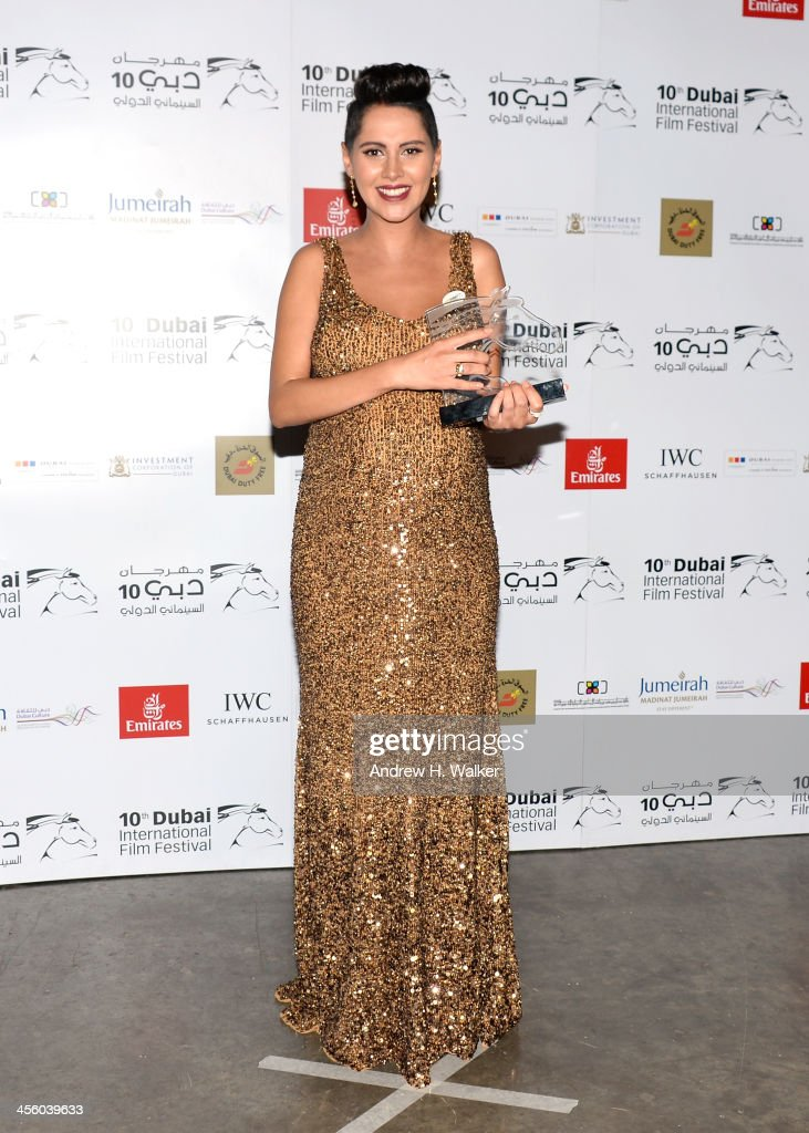 Yasmine Raees with her Arab Feature Best Actress award at the Muhr Awards during day eight of the 10th Annual Dubai International Film Festival held at the Madinat Jumeriah Complex on December 13, 2013 in Dubai, United Arab Emirates.