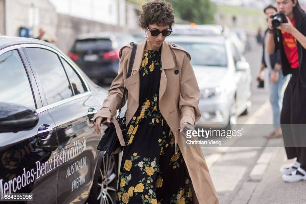Yasmine Sewell wearing a trench coat dress with floral print outside Ten Pieces at day 5 during MercedesBenz Fashion Week Resort 18 Collections at...