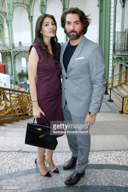 Yasmine Torjemane and Adlan Kaezar attend the 'Revelations' Fair at Balcon d'Honneur du Grand Palais on May 5 2017 in Paris France