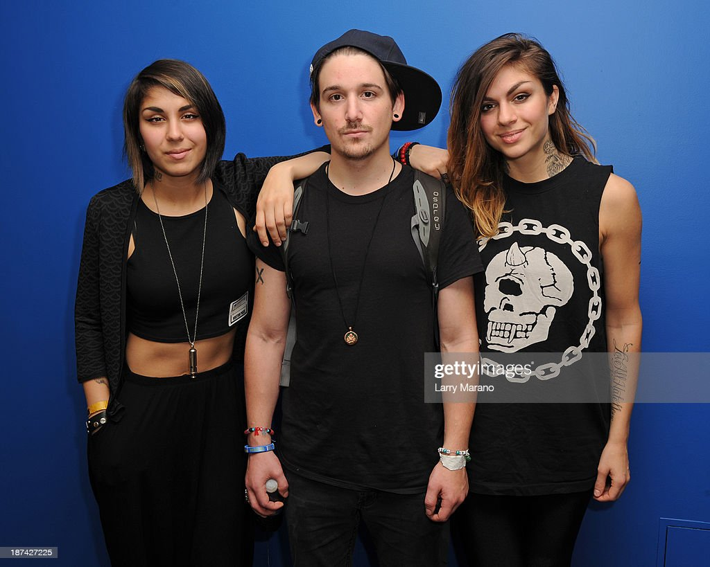 Yasmine Yousaf, Kris Trindl and Jahan Yousaf of Krewella pose for a portrait at Y 100 radio station on November 8, 2013 in Miami, Florida.