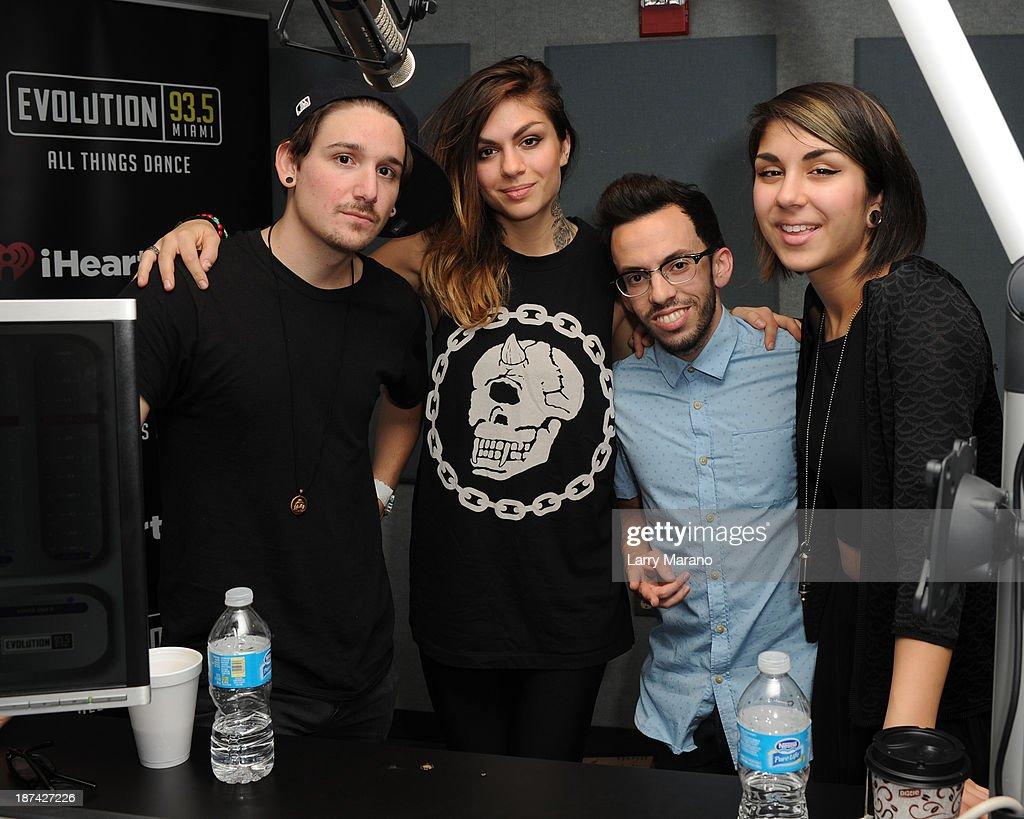 Yasmine Yousaf, Kris Trindl and Jahan Yousaf of Krewella pose with DJ Obscene at Y 100 radio station on November 8, 2013 in Miami, Florida.