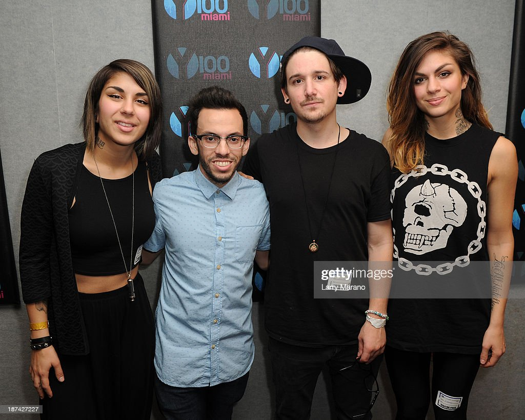 Yasmine Yousaf, Kris Trindl and Jahan Yousaf of Krewella pose with DJ Obscene at Y 100 radio station on November 8, 2013 in Miami, Florida.