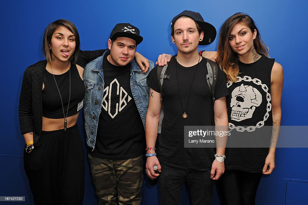 Yasmine Yousaf, Kris Trindl and Jahan Yousaf of Krewella pose with DJ Mack at Y 100 radio station on November 8, 2013 in Miami, Florida.