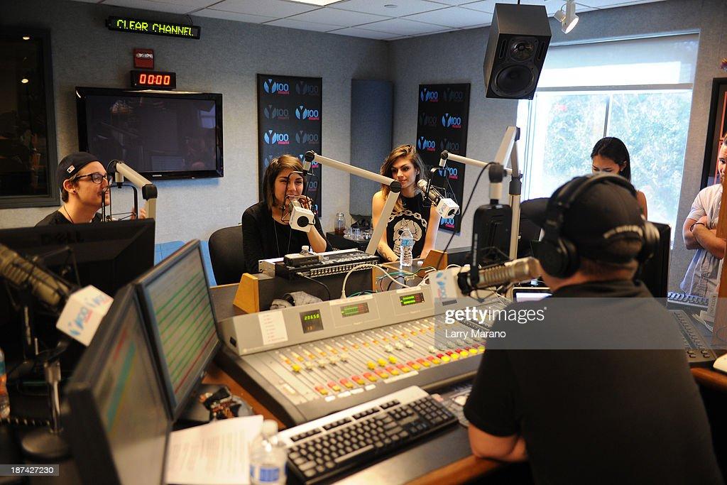 Yasmine Yousaf, Kris Trindl and Jahan Yousaf of Krewella visit Y 100 radio station on November 8, 2013 in Miami, Florida.