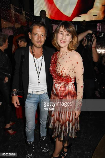 Yassen Samouilov from On Aura Tout Vu and Alexia Laroche Joubert attend the 'Red Defile' Auction Fashion Show Hosted by Ajila Association Association...